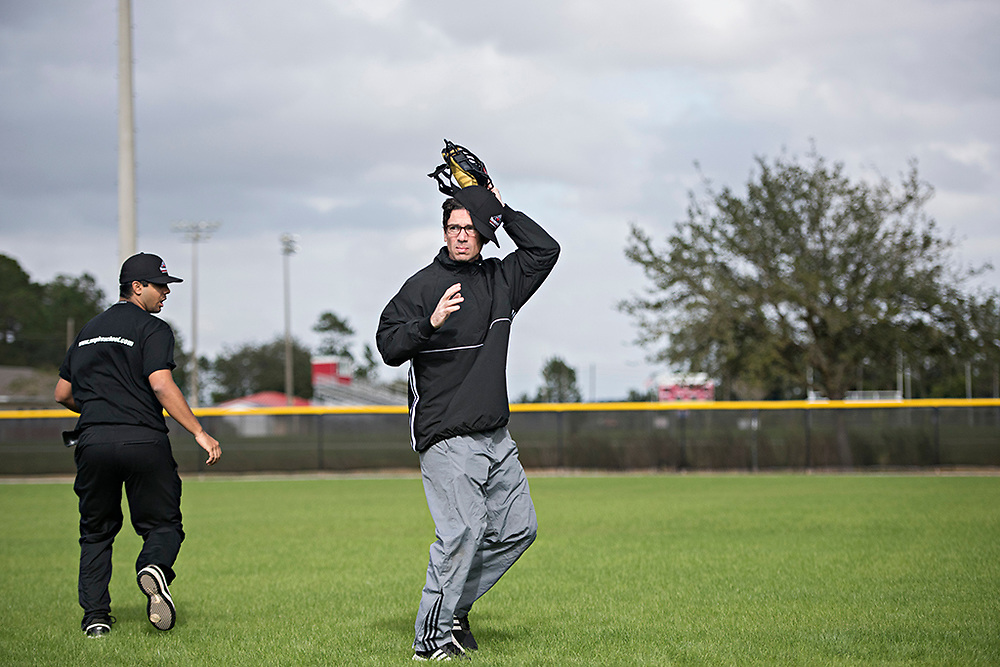 """DAYTONA BEACH, FL - JANUARY 5, 2016:  Seth Stevenson works on the basics, like getting his mask off without losing his hat, during the first week of training at the Wendelstedt Umpire School in Daytona Beach, Fla. Stevenson is a writer for Slate Magazine, who attended the school so he could write """"the greatest story of his career."""" (Photo by Melissa Lyttle)"""
