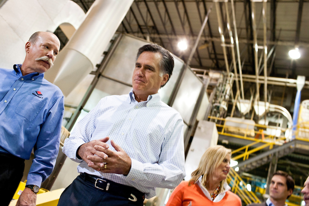 Republican presidential candidate Mitt Romney tours the Diamond V South Plant before a campaign town hall meeting on Friday, December 9, 2011 in Cedar Rapids, IA.
