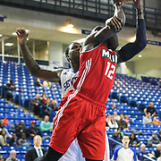 Delaware 87ers Forward Victor Rudd (23) fouls Maine Red Claws Guard Jermaine Taylor (12) in the first half of a NBA D-league regular season basketball game between the Delaware 87ers and the Maine Red Claws (Boston Celtics) Friday, Dec. 12, 2014 at The Bob Carpenter Sports Convocation Center in Newark, DEL