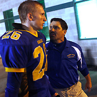 Salmon River head coach Charlie Shepherd lets McCoy Hale know how much the team needs him to give full effort as the two walk to the locker room at halftime in the 1A Division II state championship at Eagle High School on Nov. 16. Hale was knocked out on a play in the first half, and did not return to the game. Salmon River went on to win the 1A DII state title.