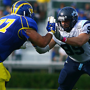 University of Maine defensive lineman Michael Cole (99) battles Delaware Offensive Tackle Brandon?Heath (77) in the pocket during a Week 6 NCAA football game against Maine University.