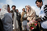 Kabul: Goodwill Ambassador, Angelina Jolie, is presented a bouquet of flowers by young school girls at the site of a proposed girl school in the village of Qala Gudar, Qarabagh District, some 28km outside Kabul.<br /> <br /> Angelina Jolie was visiting the site where she will fund a new girls primary school.<br /> <br /> Girls are only currently studying part of the year in the open air in the grounds of a local mosque and limited to Grade 4 due to lack of a school building<br /> <br /> Afghanistan. /UNHCR/Jason Tanner/February 2011