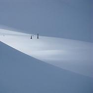 Spring light races across a snowy landscape near Whistler, BC.