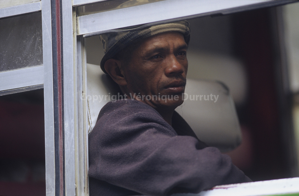 BONTOC MAN IN A PUBLIC BUS IN THE CORDILLERA, NORTH LUZON, THE PHILIPPINES