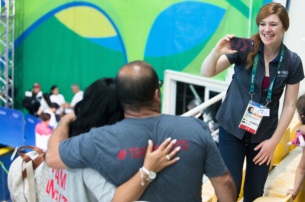 Father Arthur Benfeito and Mother Margie Correia celebrate their daughter Meaghan Benfeito 10 meter bronze medal performance at the Rio Olympics on August 18, 2016.