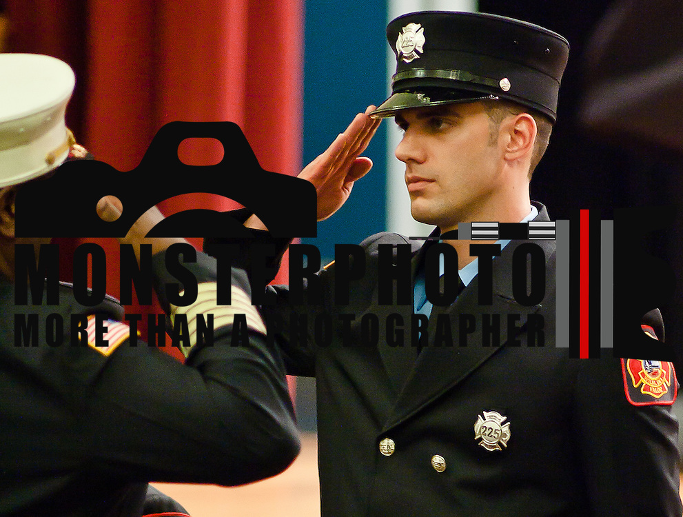 10/16/11 Wilmington DE: Probationary firefighter Vincent G. Lavella salutes Chief of Fire Willie J. Patrick Jr during Wilmington Fire Academy Graduation Ceremony Monday, Oct. 17, 2011 at P.S. Dupont Middle school in Wilmington Delaware...Funding for 13 of the 14 members of the current class is coming from a controversial grant approved by City Council this past spring...The 13 men and one woman make up the 36th Wilmington Fire Department Academy, which will bring the department up to 173 members...The News Journal/SAQUAN STIMPSON