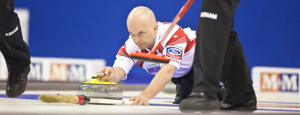 Canadian third Jon Mead delivers his shot during Canada's 1-2 playoff match against Scotland at the Ford World Men's Curling Championships in Regina, Saskatchewan, April 8, 2011.<br /> AFP PHOTO/Geoff Robins