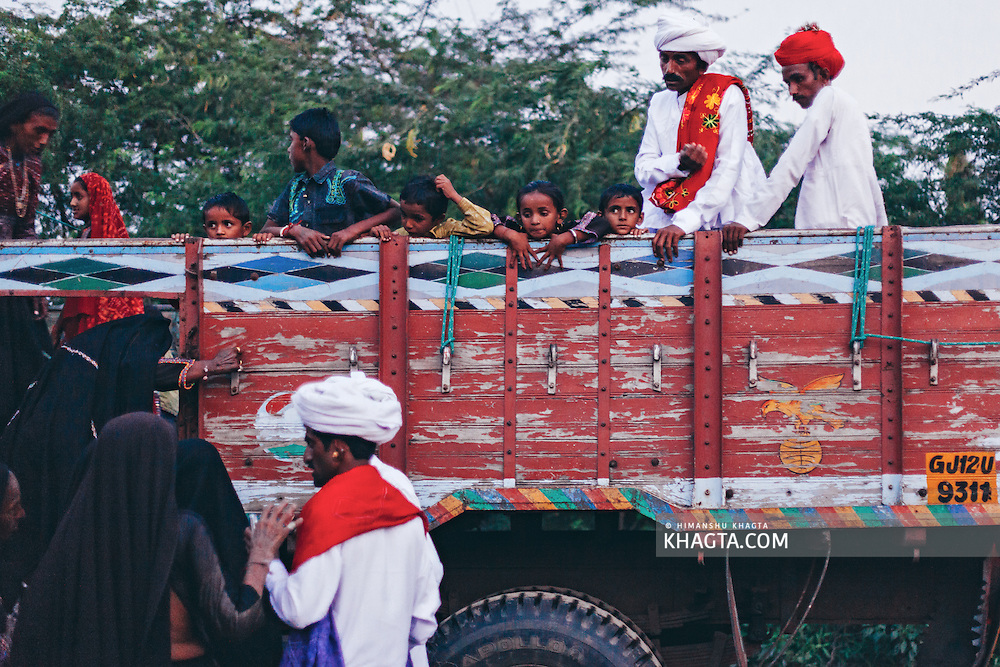 People of Maldhari tribe waiting to get in the truck the village hired to reach the village of the bride.