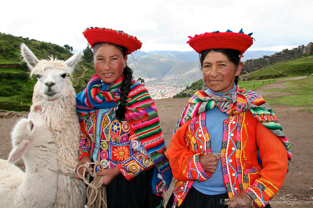 Americas, South America, Peru, Cusco. Peruvian women with llamas.