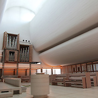 The Bagsv&aelig;rd Church by J&oslash;rn Utzon was completed in 1976. Though not his most famous work, the church is an example of the architect&rsquo;s inventive work at a different scale. Utzon designed the church with an unassuming exterior that merely hints at the stirring forms he created inside.<br /> The Bagsv&aelig;rd Church was Utzon&rsquo;s first work after returning to Denmark from Austrailia and the Sydney Opera House, which he designed. It is located on the northern outskirts of Copenhagen in a suburban setting. The church stands almost unassuming as a simple, modern structure amidst birch trees, with its back to a local street. But when you enter, it will mesmerize you. We visited it in January 2013 and are completely fascinated.