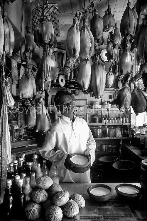 Sri Lanka.<br /> Man in his 'curd and honey' shop in Galle Market.