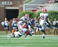 Ole Miss' Zack Stoudt (8) is tackled by Georgia linebacker Amarlo Herrera (52) and Georgia linebacker Jarvis Jones (29) at Vaught-Hemingway Stadium in Oxford, Miss. on Saturday, September 24, 2011. Georgia won 27-13.