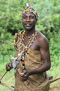 Africa, Tanzania, Lake Eyasi, Hadza male with a bird spiked on an arrow Small tribe of hunter gatherers AKA Hadzabe Tribe April 2006