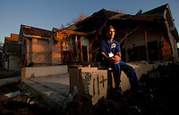 """""""When I got to Lakeview, I really cried. I was thinking about other people, when I saw the damage to other people's property, I didn't think about myself anymore.""""..""""I personally can't blame anybody...that's why they call [it a] disaster. It is something that if they know they would do something about it, but It has happened. They have tried to fix the problem and if they don't it is going to be again the same thing."""" ...Hadi Amini's home was only 50 yards from the 17th Street Canal in New Orleans when the levee broke following Hurricane Katrina two months ago. A section of his home was completely missing and the rest of his home ruined by the floodwaters. Wednesday, Nov. 2, 2005.  (Robert Caplin/The New York Times)..."""