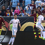 Venezuela Midfielder ARQUIMEDES FIGUERA (5) and Uruguay Defender ALVARO PEREIRA (6) battle for the ball in the first half of a Copa America Centenario Group C match between Uruguay and Venezuela Thursday, June. 09, 2016 at Lincoln Financial Field in Philadelphia, PA.