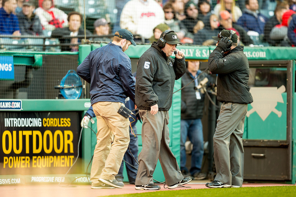 CLEVELAND OH -April 10, 2015: Umpire Dale Scott waiting for word from New York for an instant replay during the game between the Detroit Tigers and the Cleveland Indians at Progressive Field on April 10, 2015 in Cleveland, Ohio. (Photo by Jean Fruth)