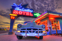 A vintage car and Art Deco neon light up The Blue Swallow Motel Along Route 66 in Tucumcari, New Mexico, Aug. 11, 2011. WildWest-Media Photo by Colin E. Braley