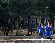Two North Korean girls stand on the bank of the Yalu river in Sinuiju