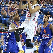 Delaware 87ers Guard Melvin Johnson (21) attempts a shot in the paint in the first half of a NBA D-league regular season basketball game between the Delaware 87ers and the Westchester Knicks (New York Knicks) Sunday, Dec. 28, 2014 at The Bob Carpenter Sports Convocation Center in Newark, DEL