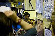 Street vendor selling cloths and hats inside Fez Medina.