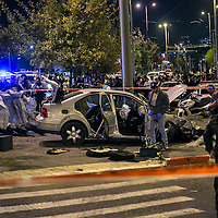 Police officers secure the site of a car attack on Israeli civilian in Jerusalem.