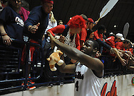 "Mississippi's Demarco Cox (4) celebrates with the student section following the game against Mississippi State at the C.M. ""Tad"" Smith Coliseum in Oxford, Miss. on Wednesday, January 18, 2012. Mississippi won 75-68. (AP Photo/Oxford Eagle, Bruce Newman)."