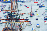 19-8-2015 AMSTERDAM - a colombian tall ship arrive in amsterdam all Ships arrive in Amsterdam center for the sail 2015 , Tall Ships, Ships and spectators and along the IJ river during the Sail-In Parade, the traditional opening of Sail Amsterdam. COPYRIGHT ROBIN UTRECHT <br /> 19-8-2015  AMSTERDAM - een colombiaans tallship  komt aan in amsterdam centraal station cs allships stad amsterdam komen aan in Amsterdam centrum voor de sail 2015 , Tallships, Schepen en publiek op en langs het IJ rivier tijdens de Sail-In Parade, de traditionele opening van Sail Amsterdam. vanaf het moevenpick hotel in amsterdam COPYRIGHT ROBIN UTRECHT