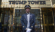 A doorman at Trump Tower in New York reacts to a street photographer.