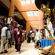 People walk through one of the pavillions at the 22nd Salon International de l'Artisanat de Ouagadougou (SIAO) in Ouagadougou, Burkina Faso on Saturday November 1, 2008.