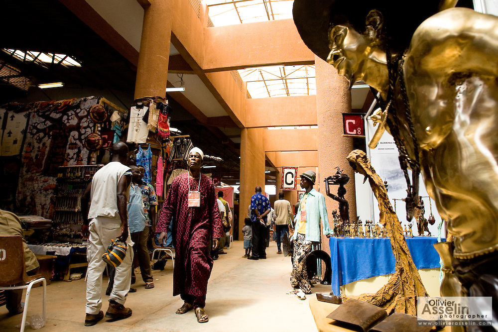 People walk through one of the pavillions at the 22nd Salon International de l'Artisanat de Ouagadougou (SIAO) in Ouagadougou, Burkina Faso on Saturday November 1, 2008.
