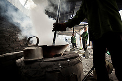 Vietnamese women working in a foundry of Man Xa, a village in the outskirts of Hanoi considered as one of the most polluted place in Vietnam, Southeast Asia