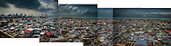 Baseco slum sits low, on reclaimed land in Manila's Port Area just a meter or two above Manila Bay, in a seismically active region.  Manila, Philippines.  It has a population density of nearly 78,000 people per square km (202,800 ppl/sq mi), according to a 2009 Cornell University report.  (Note: Manhattan has a population density of 26,939/km2 [69,771/sq mi].)<br /> <br /> While the extreme poverty rate in the region dropped significantly between 2005 and 2008, the Philippines' poverty rate remained largely unchanged.  In fact, poverty has intensified on the poor.  According to the National Statistics Coordination Board (NSCB) in 2006, 28.8% of families lived on less than US$1.25/ day.  <br /> <br /> What what changed was the income per family needed to escape extreme poverty.  While in 2006, a family would need to earn US$39.09 / month to escape extreme poverty, that figure rose in the most recent NSCB survey to US$ 181.89/month, clear showing how inflation is weighing heaviest upon that society's poor.