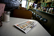 A newspaper sits on a table in the Manchester Diner on presidential primary day in Manchester, N.H., on Tuesday, Jan. 8, 2008.