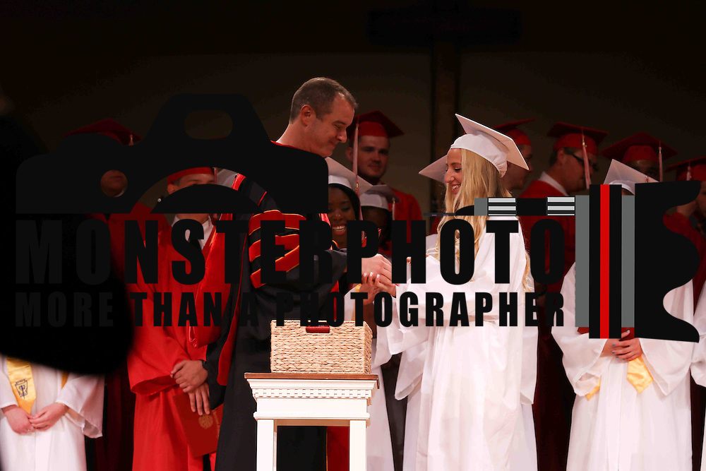 Red Lion Christian Academy candidates for graduation Abigail Scott receives her diploma during commencement exercise Friday, May 29, 2015, at Glasgow Church in Bear, Delaware.