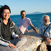 Members of the TEM  committee (local alternative currency  of Volos) in the port of Volos.  L-R: Dimitra Dodi 36, Evripides Siouras 28, Thodoris Mavridis 54