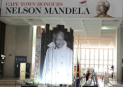 The City of Cape Town is hosting a photo exhibition of the late President Nelson Mandela in the Civic Centre in Cape Town, South Africa. Visitors also placed flowers and wrote condolence messages, South Africa, Sunday, 8th December 2013. Picture by Roger Sedres / i-Images