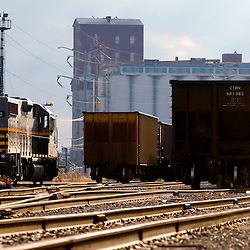 In a heavily industrialized part of the south side of Chicago, a Belt Railway of Chicago locomotive rests for the evening at a coal transfer yard.