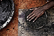 This is one the dangerous mixture of chemical used in fireworks which catches fire in dried state.So the workers need to make sure that it doesn't get dried. Image © Balaji Maheshwar/Falcon Photo Agency