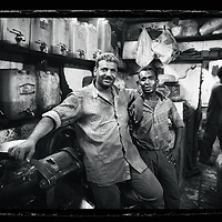 Cairo, Egypt  June 2008<br /> Two spice crushers pose for the photograher in Khan El-Kalili market.<br /> Photo: Ezequiel Scagnetti