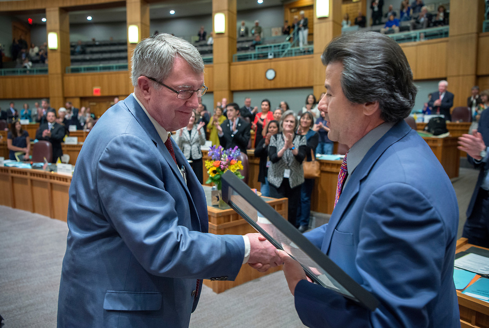 em031817g/a/Sen. Minority Leader Stuart Ingle, R-Portales, left, recieves a plaque from Sen. Pete Campos at the end of the 2017 Legislative Session at the Roundhouse in Santa Fe, Saturday March 18, 2017. (Eddie Moore/Albuquerque Journal