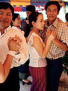 """Dancers at Lao """"naming"""" ceremony for newborn child."""