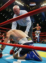 July 24, 2004; Atlantic City, NJ; USA; Arturo Gatti jumps in celebration as referee Randy Neuman reaches the 10 count over a fallen Leonard Dorin.  Gatti won the bout via 2nd round KO.