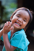 Young girl laughing,  Mae Sam Laep, Mae Hong Son Province, Thailand