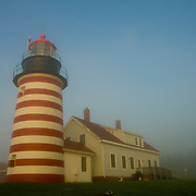 Early morning fog surrounds the Quoddy Lighthouse near Lubec, Maine.