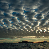 Dusk in the channel between Sombrero Chino island and Santiago Island in the Galapagos
