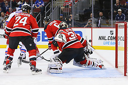Oct 21, 2014; Newark, NJ, USA; New York Rangers left wing Chris Kreider (20) scores a goal on New Jersey Devils goalie Cory Schneider (35) during the first period at Prudential Center.