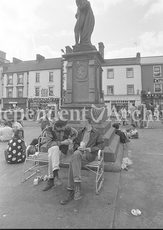 Fans enjoying the Feile Festival in Thurles, Tipperary, 02/08/1991 (Part of the Independent Newspapers Ireland/NLI Collection).