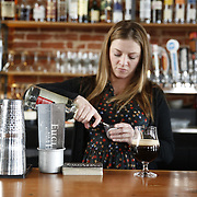 """SHOT 3/25/14 2:58:19 PM - Euclid Hall bar manager Jessica Cann of Denver, Co. prepares a """"Return of the Naughty Girl Scout"""", a beer cocktail that mixes chocolate liquer, coffee liqueur, peppermint schnapps, and Left Hand Nitro Milk Stout beer $11. (Photo by Marc Piscotty / © 2014)"""