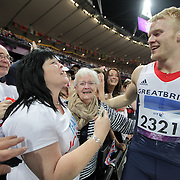 Great Britain's Jonnie Peacock  after winning the 100m at the Paralympic Games and celebrating with his  family (mother Linda Roberts white T shirt) . Peacock  will receive an MBE after being named in the New Year Honours list.