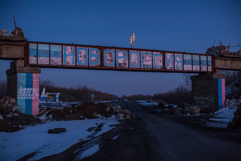 DEBALTSEVE, UKRAINE - FEBRUARY 20: A bridge painted with with Novorossiya, the name of the self-proclaimed separatist republic in Eastern Ukraine, on February 20, 2015 in Debaltseve, Ukraine. Ukrainian forces withdrew from the strategic and hard-fought town after being effectively surrounded by pro-Russian rebels, though fighting has caused widespread destruction. (Photo by Brendan Hoffman/Getty Images) *** Local Caption ***